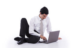 Young Businessman with his laptop Stock Photography