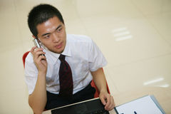 Young  businessman in his office Stock Images
