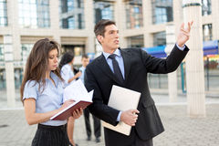 Young Businessman With His Secretary Stock Photo