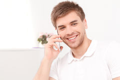 Young businessman with his smartphone Royalty Free Stock Images