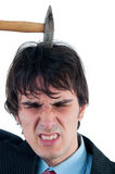 Young businessman hit in the head by hammer Stock Photo