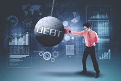 Young businessman hitting debt word Royalty Free Stock Photo