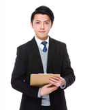 Young businessman hold with clipboard Stock Photography
