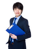 Young Businessman hold with clipboard Stock Image
