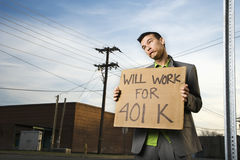 Young Businessman Holding 401k Sign Stock Photos