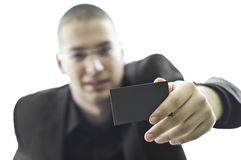 Young Businessman Holding A Business Card Stock Photo