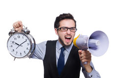 The young businessman holding alarm clock isolated Royalty Free Stock Photo