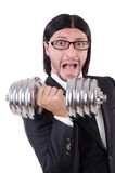 Young businessman holding barbell isolated on Stock Images
