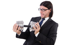 The young businessman holding barbell isolated on Royalty Free Stock Photo