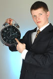 Young businessman holding big clock Royalty Free Stock Photography