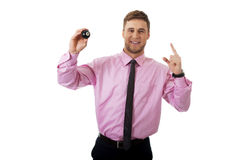 Young businessman holding billiard ball. Stock Photo