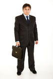 Young businessman holding briefcase in hand Royalty Free Stock Images