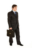 Young businessman holding briefcase in hand stock image