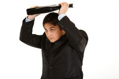 Young businessman holding briefcase over head Stock Photos