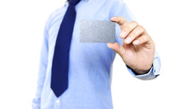 Young businessman holding business card stock image