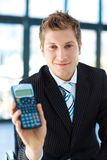 Young businessman holding a calculator Royalty Free Stock Image