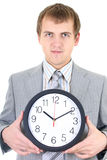 Young businessman holding a clock Royalty Free Stock Photos