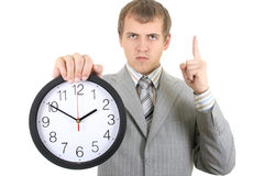 Young businessman holding a clock Royalty Free Stock Photo