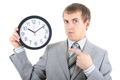 Young businessman holding a clock Stock Image