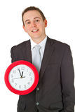 Young businessman holding a clock Royalty Free Stock Image