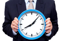 Young businessman holding a clock Stock Photography