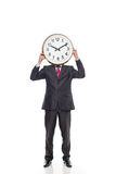 Young businessman holding a clock. Image Stock Image