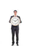 Young businessman holding a clock. Isolated image Royalty Free Stock Photography