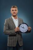 Young businessman holding a clock Stock Photos