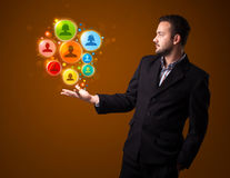 businessman holding colorful social network icons in his hand royalty free stock photos