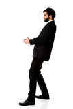 Young businessman holding copy space. stock photo