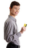 Young businessman holding credit card Stock Photo
