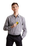 Young businessman holding credit card Stock Photos