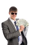Young businessman holding dollars Stock Image