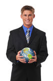 Young businessman holding the earth royalty free stock image