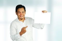 Young Businessman Holding Empty Paper Stock Photo