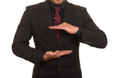 Young businessman holding empty space Royalty Free Stock Photography