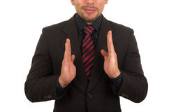 Young businessman holding empty space Stock Photography