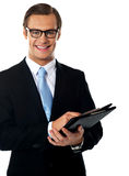Young businessman holding a folder Stock Photo