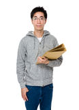 Young businessman holding with folder Royalty Free Stock Image