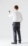Young businessman holding a goblet of wine Royalty Free Stock Photography