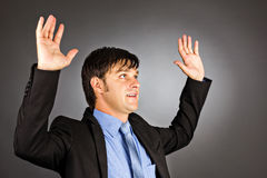 Young businessman holding his arms up Royalty Free Stock Photo