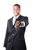 Young businessman holding a key Stock Photography