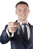 Young businessman holding a key Stock Image