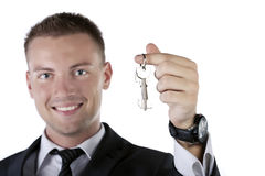 Young businessman holding a key Stock Photos