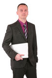 Young businessman holding a laptop Royalty Free Stock Photography
