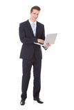 Young Businessman Holding Laptop Stock Image