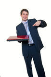 Young businessman holding laptop pointing on it Royalty Free Stock Photos