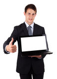 Young businessman holding laptop with thumbs up Royalty Free Stock Image