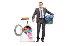 Young businessman holding a laundry basket Royalty Free Stock Image