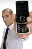 Young businessman holding mobile Stock Photos